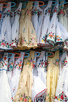 Embroidered white children's dresses for sale in Playa del Carmen, Riviera Maya, Quintana Roo, Mexico.