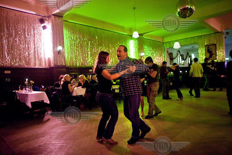 Couples on the dance floor at Claerchen's Ballhaus. This old East Berlin ballroom has long been popular among the local working class residents but is in an area now under threat of redevelopment by incoming middle class gentrifiers..