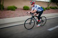 Seth O'Brien trains for an upcoming event on his triathalon bike on the roads near his home in Ahwatukee.  In addition to being a triathalete and father, the amputee  is a prostheticist fabricating new limbs for clients.