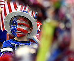 Cameron Szemreylo, 4, of Tolland, flashes a smile as he decked out with a U.S.A flag face, prior to the kids parade, part of Vernon's July in the Sky activities, Wednesday, July 6, 2016, in downtown Rockville. (Jim Michaud / Journal Inquirer)