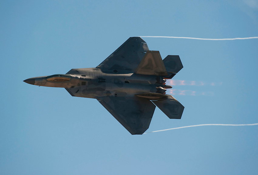"""121014-N-DR144-472 SAN DIEGO (October 14, 2012)- A United States Air Force F-22 Raptor performs during the Marine Corps Air Station Miramar 2012 Air Show. The air show, held October 12-14, was themed """"Marines In Flight: Celebrating 50 Years of Space Exploration."""" (U.S. Navy photo by Mass Communication Specialist 1st Class James R. Evans / RELEASED)"""