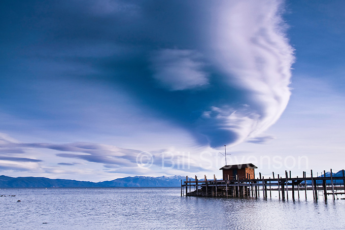 A photo of a lenticular cloud above the pier at Commons Beach in Tahoe City on Lake Tahoe in California