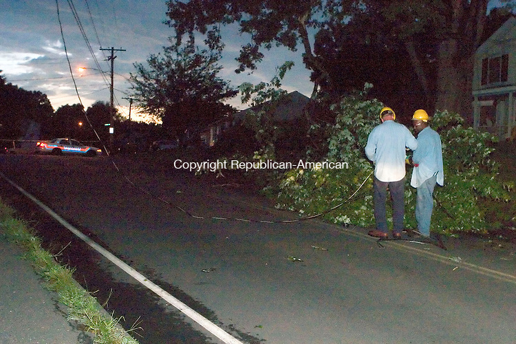 WATERTOWN, CT- 03 AUGUST 06- 080306JT05-<br /> Connecticut Light and Power workers Tony DePasqua and Mike Farrow work to raise a power line that was downed by a large tree branch on Davis Street in Watertown as a strong thunderstorm passed through the area on Thursday evening. <br /> Josalee Thrift Republican-American