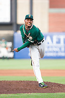 Greensboro Grasshoppers starting pitcher Jarlin Garcia (33) follows through on his delivery against the Hagerstown Suns at NewBridge Bank Park on June 21, 2014 in Greensboro, North Carolina.  The Grasshoppers defeated the Suns 8-4. (Brian Westerholt/Four Seam Images)