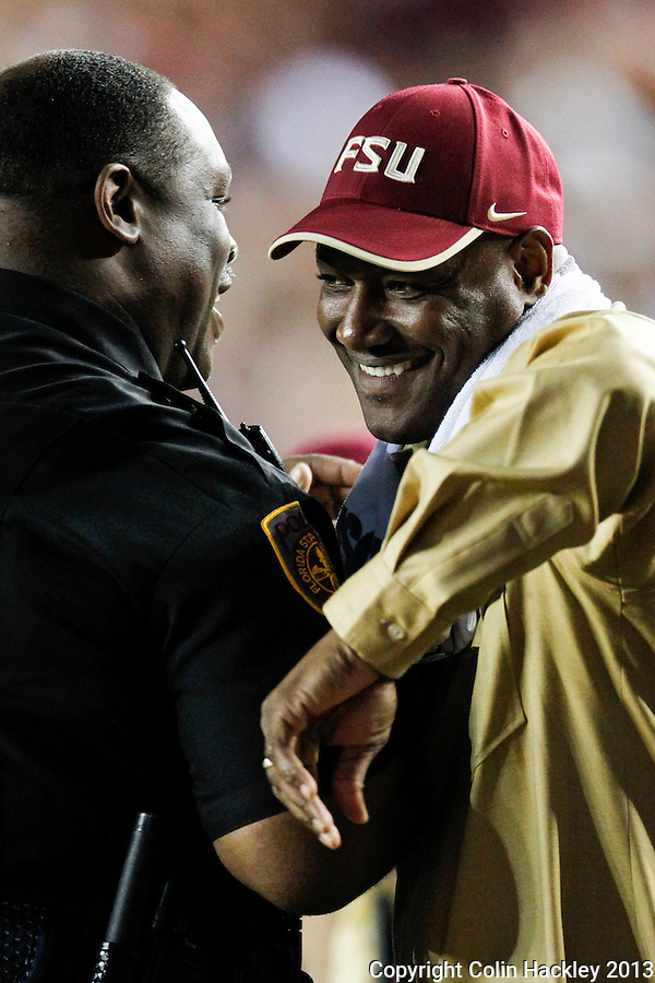 TALLAHASSEE, FL 11/2/13-FSU-MIAMI110213CH-Former Florida State Linebacker Derrick Brooks is greeted by FSU Police Chief David Perry during the Miami game Saturday at Doak Campbell Stadium in Tallahassee. The Seminoles beat the Hurricanes 41-14.<br /> COLIN HACKLEY PHOTO
