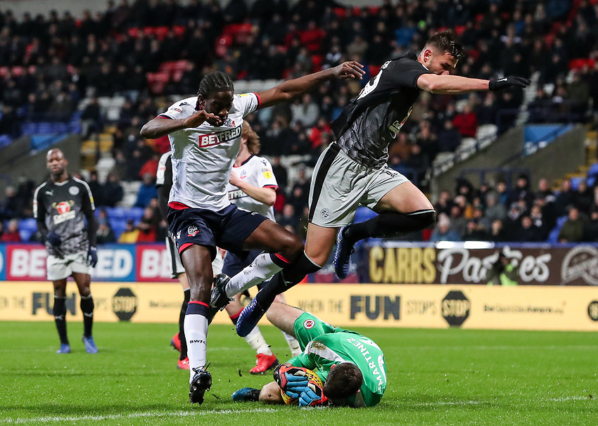 Bolton Wanderers' goalkeeper Emiliano Martinez saves under pressure from Bolton Wanderers' Clayton Donaldson as Reading's  Matt Miazga leaps out of the way<br /> <br /> Photographer Andrew Kearns/CameraSport<br /> <br /> The EFL Sky Bet Championship - Bolton Wanderers v Reading - Tuesday 29th January 2019 - University of Bolton Stadium - Bolton<br /> <br /> World Copyright © 2019 CameraSport. All rights reserved. 43 Linden Ave. Countesthorpe. Leicester. England. LE8 5PG - Tel: +44 (0) 116 277 4147 - admin@camerasport.com - www.camerasport.com