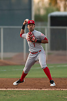 AZL Reds third baseman Debby Santana (7) makes a throw to first base during an Arizona League game against the AZL Cubs 2 at Sloan Park on June 18, 2018 in Mesa, Arizona. AZL Cubs 2 defeated the AZL Reds 4-3. (Zachary Lucy/Four Seam Images)