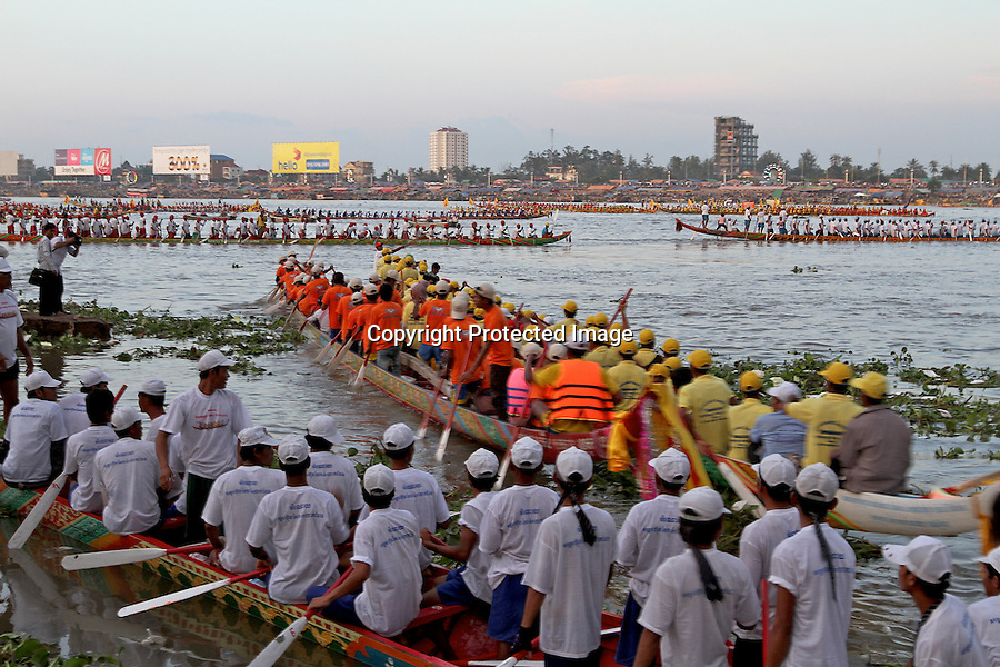 On the last day of the water festival 2010, in Phnom Penh, boats gather in the middle of the Tonle Sap and pass by before the King of Cambodia-2010