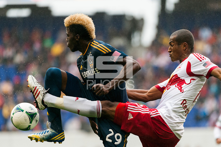Gyasi Zardes (29) of the Los Angeles Galaxy and Roy Miller (7) of the New York Red Bulls. The New York Red Bulls defeated the Los Angeles Galaxy 1-0 during a Major League Soccer (MLS) match at Red Bull Arena in Harrison, NJ, on May 19, 2013.