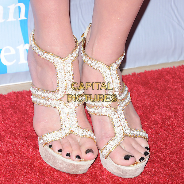 Ashlee Simpson's shoes .attends the An Evening With Women held at The Beverly Hilton in Beverly Hills, California, USA, May 19th,2012..detail white sandals platform gold black toes toe nails pedicure nail varnish polish .CAP/RKE/DVS.©DVS/RockinExposures/Capital Pictures.
