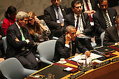United States President Barack Obama listens to translations of other leader's remarks as he chairs the United Nations Security Council summit cracking down on foreign terrorist fighters at the United Nations 69th General Assembly in New York, New York on Wednesday, September 24, 2014. Visible in the photo are also U.S. Secretary of State John F. Kerry and U.S. Ambassador to the U.N. Samantha Power.<br /> Credit: Allan Tannenbaum / Pool via CNP