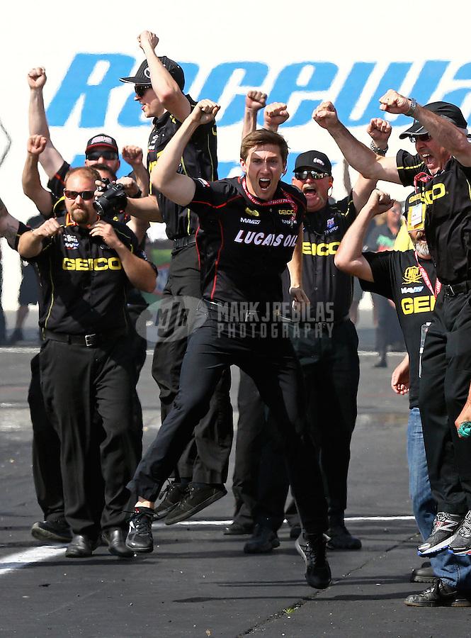 Jun. 1, 2014; Englishtown, NJ, USA; NHRA top fuel team owner Morgan Lucas celebrates after driver Richie Crampton (not pictured) wins the Summernationals at Raceway Park. Mandatory Credit: Mark J. Rebilas-