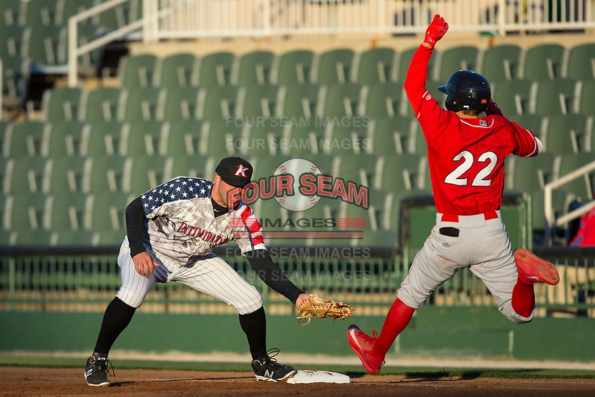 Brandon Dulin (31) of the Kannapolis Intimidators can't field a throw as Mickey Moniak (22) of the Lakewood BlueClaws lunges for first base at Kannapolis Intimidators Stadium on April 7, 2017 in Kannapolis, North Carolina.  The BlueClaws defeated the Intimidators 6-4.  (Brian Westerholt/Four Seam Images)