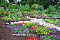 63821-21808 Flower garden with stone paths, obelisk, bird bath, & bird house.  Homestead Purple Verbena (Verbena canadensis), Red Verbena, New Gold Lantana (Lantana camara) Butterfly Bushes, Zinnias, Joe Pye Weed (Eupatorium purpureum)  Marion Co., IL