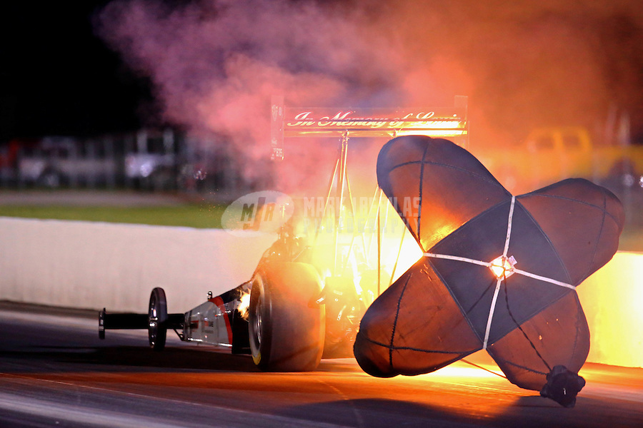 Sep 5, 2015; Clermont, IN, USA; NHRA top fuel driver Wayne Newby has a fire as he deploys his parachute after an engine explosion during qualifying for the US Nationals at Lucas Oil Raceway. Mandatory Credit: Mark J. Rebilas-USA TODAY Sports