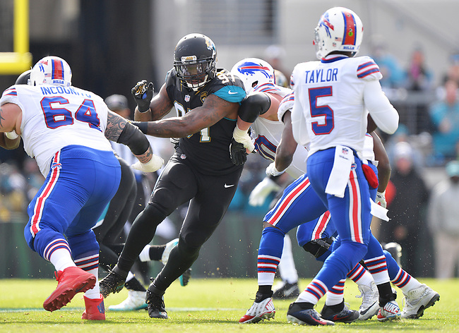 Jacksonville Jaguars defensive tackle Malik Jackson (97) gets through a block on a play he sacked Buffalo Bills quarterback Tyrod Taylor (5) in a NFL Wildcard Playoff game Sunday, January 7, 2018 in Jacksonville, Fl.  (Rick Wilson/Jacksonville Jaguars)