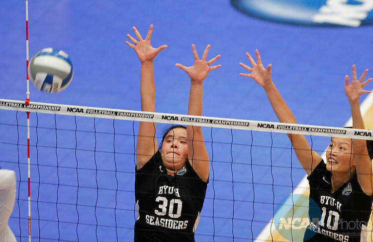 14 DEC 2013 BYU-Hawaii's Ying Chun (Michelle) Chen (30) and Erh Fang (Ariel) (10) look to block a spike during the Division II Women's Volleyball Championship game held at the U.S. Cellular Center in Cedar Rapids, IA.  Concordia-St. Paul won over BYU-Hawaii in 3 straight sets to claim the championship title. <br />