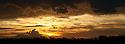 Line of Acacia trees (Acacia sp.) with dramatic storm clouds and sun set behind. Near Ndutu, Ngorongoro Conservation Area / Serengeti National Park, Tanzania.