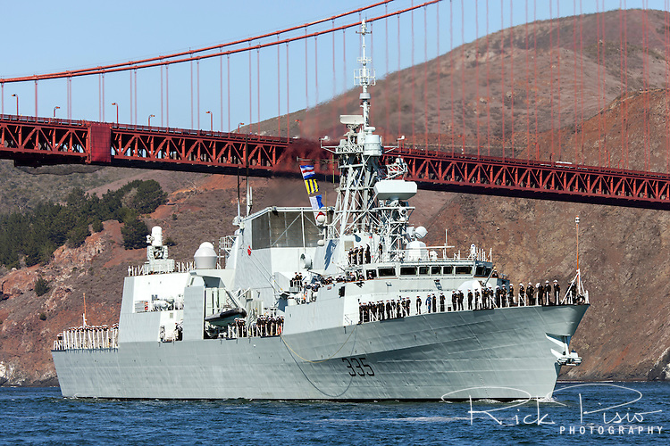 Halifax-class frigate HMCS Calgary (FFH 335) passes under the Golden Gate Bridge and enters San Francisco Bay. The Calgary was officially commissioned into the Canadian Forces on 12 May 1995.