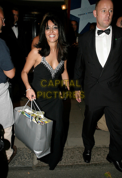 LAILA ROUASS.TV Quick & TV Choice Awards at the Dorchester Hotel, Park Lane, London..September 5th, 2005.full length goody bag black dress.www.capitalpictures.com.sales@capitalpictures.com.© Capital Pictures.
