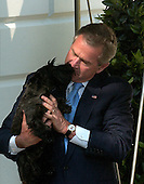 Washington, D.C. - May 21, 2005 -- United States President George W. Bush gets a welcoming lick from Miss Beezley, the youngest of his two dogs, as he arrives at the White House in Washington, DC aboard Marine One on May 21, 2005.  He addressed the Calvin College Commencement in Grand Rapids, Michigan earlier in the day.<br /> Credit: Ron Sachs  - Pool via CNP