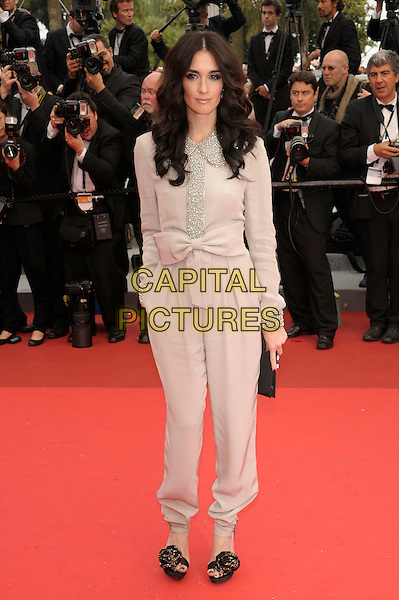 PAZ VEGA.Attending the 'Pirates of the Caribbean: On Stranger Tides' premiere, Palais des Festivals during the 64th International Cannes Film Festival, Cannes, France,.14th May 2011..4 four full length cream beige catsuit jumpsuit bow  collar beaded silver  blouse trousers black flower open toe shoes clutch bag hand in pocket .CAP/PL.©Phil Loftus/Capital Pictures.
