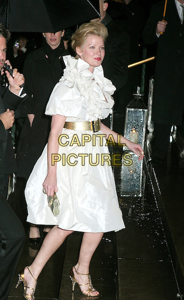 GRETCHEN MOL.Elton John celebrates his 60th birthday party at St. John The Devine Catherdral, New York, NY, USA. .March 24th, 2007.full length white dress ruffles gold belt silver clutch purse shoes .CAP/IW.©Ian Wilson/Capital Pictures