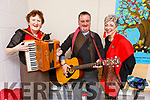 Orla Begley, Fr Francis Nolan and Mary Conroy at the Christmas Concert in Blennerville National School Hall on Sunday.
