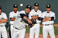 Starting pitcher Colin Holderman (11) of the Columbia Fireflies warms up in front of the pitching staff before a game against the Lexington Legends on Saturday, April 22, 2017, at Spirit Communications Park in Columbia, South Carolina. Lexington won, 4-0. (Tom Priddy/Four Seam Images)