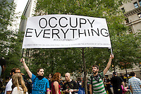 Protesters continue to gather in Liberty Square in lower Manhattan, New York on 30 September 2011, day 13 of Occupy Wall Street, a resistance movement targeting corporate greed and corruption.