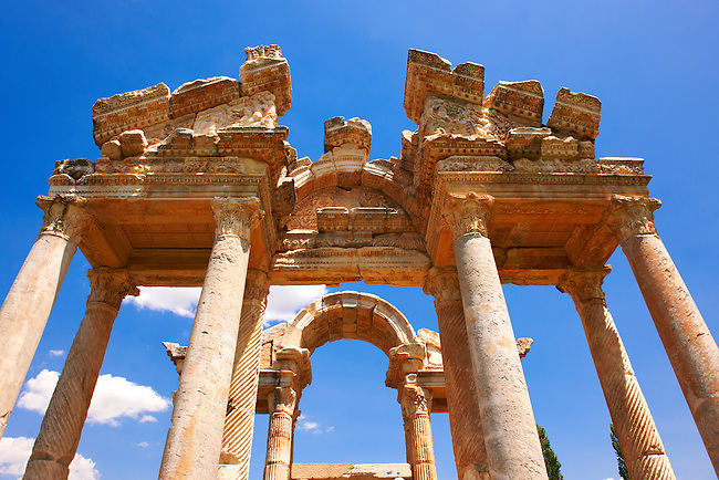 "Picture of the double Tetrapylon Gate, Aphrodisias, Turkey. A tetrapylon (Greek: Τετράπυλον, ""four gates"") is an ancient type of Roman monument of cubic shape, with a gate on each of the four sides: generally it was built on a crossroads. stock photos & photo art prints. 8"