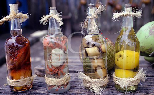 Brazil. Cachaca sugar cane alcohol with sugar cane, crabs, and fruits.