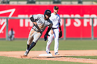 Peoria Javelinas left fielder Buddy Reed (85), of the San Diego Padres organization, rounds third base in front of Charles Leblanc (12) during an Arizona Fall League game against the Surprise Saguaros at Surprise Stadium on October 17, 2018 in Surprise, Arizona. (Zachary Lucy/Four Seam Images)