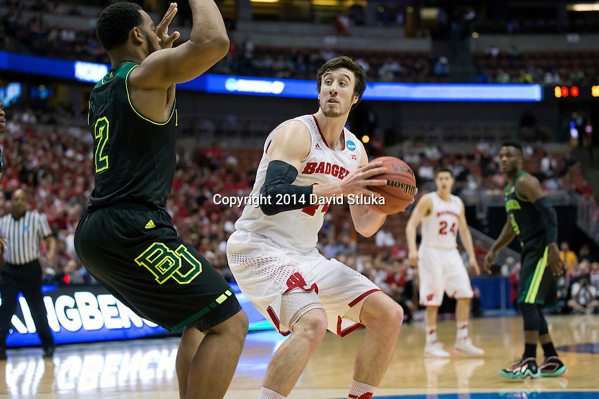 Wisconsin Badgers center Frank Kaminsky (44) handles the ball  a regional semifinal NCAA college basketball tournament game against the Baylor Bears Thursday, March 27, 2014 in Anaheim, California. The Badgers won 69-52. (Photo by David Stluka)
