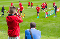 A young fan takes photographs during the Wales open Training session ahead of the opening FIFA World Cup 2018 Qualification match against Moldova at The Vale Resort, Cardiff, Wales on 31 August 2016. Photo by Mark  Hawkins / PRiME Media Images.