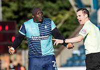 Adebayo Akinfenwa of Wycombe Wanderers remonstrates with Referee Ross Joyce during the Sky Bet League 2 match between Wycombe Wanderers and Notts County at Adams Park, High Wycombe, England on the 25th March 2017. Photo by Liam McAvoy.