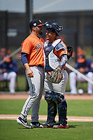Houston Astros pitcher Jose Hernandez (80) and catcher Orlando Marquez (98) during a Minor League Spring Training Intrasquad game on March 28, 2019 at the FITTEAM Ballpark of the Palm Beaches in West Palm Beach, Florida.  (Mike Janes/Four Seam Images)