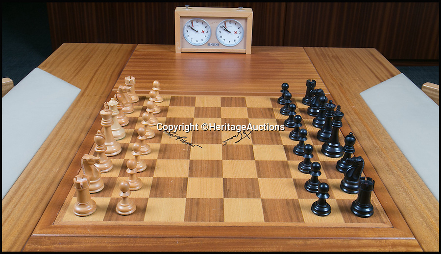 BNPS.co.uk (01202 558833)<br /> Pic: HeritageAuctions/BNPS<br /> <br /> Chess fans will need a huge cheque (mate) to get their hands on this Cold War board from the most famous match ever played - because it comes with a whopping £250,000 price tag.<br /> <br /> The 1972 clash in Iceland's capital Reykjavik between American Bobby Fischer and Russian Boris Spassky was dubbed the 'match of the century' and is largely considered the most important game in the history of chess.<br /> <br /> As well as featuring the world's two best chess players at the time, the match was seen as a symbol of the political tension between the USA and Russia caused by the Cold War.<br /> <br /> Experts at Dallas-based saleroom Heritage Auctions have tipped the board to sell for a staggering $300,000 - around £250,000 - when it goes under the hammer tomorrow (Nov17).