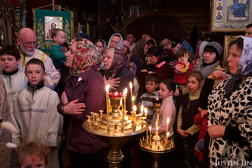 Children await the Orthodox Christian priest's blessing in the town of Slavutych, which has some of the highest birth rates in Ukraine. <br /> <br /> Slavutych rises out of the ashes of the Chernobyl nuclear disaster in April 26, 1986. People living near the disaster area were largely moved to the new city, built from scratch for the sole purpose of housing the population displaced by the nuclear accident.