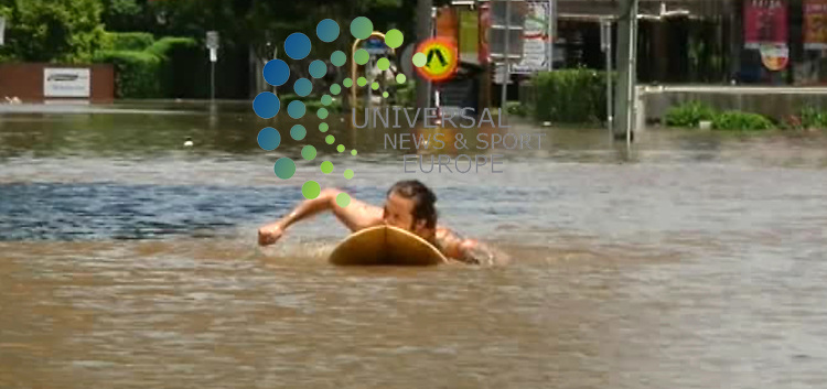 Surf's up in Frew Street: Frew Street may be a no through road at the best of times but the flooding in Brisbane has made it even more of a dead end: unless of course you take you surf board...... .Picture  Universal News And Sport (Europe)Ch7   12 January  2011 All pictures must be credited to www.unpixs.com. (0ffice) 0844 884 51 22  . (Universal News does not claim any Copyright or License in the attached material. Any downloading fee charged by Universal News and Sport is for Universal News services only. We are advised that screen images should not be used more than 48 hours after the time of original transmission, without the consent of the copyright holder)......