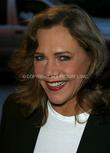 """Kathleen Turner arrives at the world premiere of MGM's """"It Runs in the Family."""" New York, April 13, 2003. Please byline: Alecsey Boldeskul/NY Photo Press.   ..*PAY-PER-USE*      ....NY Photo Press:  ..phone (646) 267-6913;   ..e-mail: info@nyphotopress.com"""