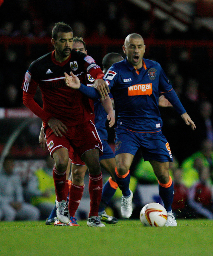 Bristol City's Liam Fontaine (L) and Blackpool's Kevin Phillips in action during todays match  ..Football - npower Football League Championship - Bristol City v Blackpool - Saturday 17th November 2012 - Ashton Gate - Bristol..
