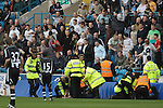 Carlisle United 1 Newcastle United 1, 21/07/2007. Brunton Park, Pre-season Friendly. Carlisle United fans in the CBS Stand watching the police taking action against spectators who had encroached onto the pitch during their team's pre-season friendly against Newcastle United at Cumbrian's Brunton Park ground. The match ended one goal each with Newcastle equalising Danny Livesey's opener through Nolberto Solano in the last minute. During the 2007-08 season Carlisle played in League One, English football's third tier, while Newcastle were a top Premiership team. Photo by Colin McPherson.