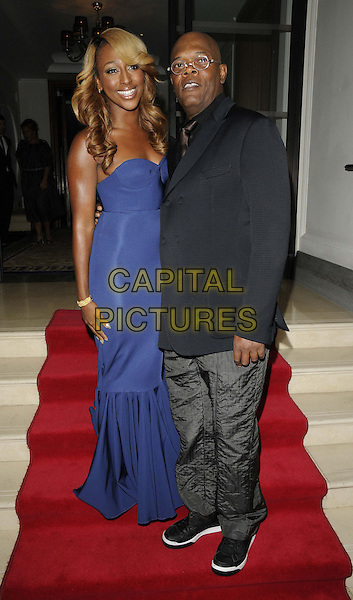 Alexandra Burke & Samuel L Jackson.attended the 'Shooting Stars Benefit' fundraising dinner & launch party, Corinthia Hotel, Whitehall Place, London, England, 20th October 2012..full length blue strapless fishtail dress long maxi smiling bustier grey gray trousers navy jacket blazer glasses .CAP/CAN.©Can Nguyen/Capital Pictures.