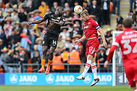 Danny Collins of Grimsby Town (2nd left) wins the ball ahead of Simeon Akinola of Barnet (left) during the Sky Bet League 2 match between Barnet and Grimsby Town at The Hive, London, England on 29 April 2017. Photo by David Horn.