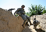 Spc. Daniel Myers, a soldier with Company C, 2nd Battalion, 508th Parachute Infantry Regiment jumps from the top of a mud wall in the village of Jelawar, in the Arghandab valley near Kandahar, Afghanistan. Because of the threat of mines, the soldiers rarely take established trails, so a typical patrol in the Arghandab consists of scrambling over one mud wall after another. April 4, 2010. DREW BROWN/STARS AND STRIPES