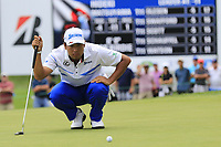 Hideki Matsuyama (JPN) lines up his putt on the 9th green during Sunday's Final Round of the WGC Bridgestone Invitational 2017 held at Firestone Country Club, Akron, USA. 6th August 2017.<br /> Picture: Eoin Clarke | Golffile<br /> <br /> <br /> All photos usage must carry mandatory copyright credit (&copy; Golffile | Eoin Clarke)
