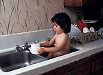 San Diego CA 2-yr-old girl, 1/2 Latina, helping mom with washing dishes in sink  MR