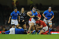 Italy&rsquo;s Michela Sillari is tackled by Wales Carys Philips  and Sioned Harries <br /> <br /> Photographer Ian Cook/CameraSport<br /> <br /> 2018 Women's Six Nations Championships Round 4 - Wales Women v Italy Women - Sunday 11th March 2018 - Principality Stadium - Cardiff<br /> <br /> World Copyright &copy; 2018 CameraSport. All rights reserved. 43 Linden Ave. Countesthorpe. Leicester. England. LE8 5PG - Tel: +44 (0) 116 277 4147 - admin@camerasport.com - www.camerasport.com
