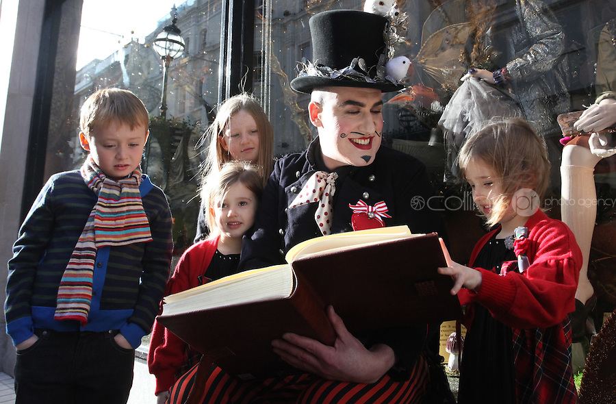 11/11/2010.Mythical Storyteller Pat Kinevane with.Ella Campbell (9) from Irishtown, Christian Clarke (7) from Castleknock.twins Amy & Eva Campbell (5) from Irishtown.at the official countdown to the unveiling of Brown Thomas's Christmas windows on Grafton street, Dublin..Photo: Gareth Chaney Collins